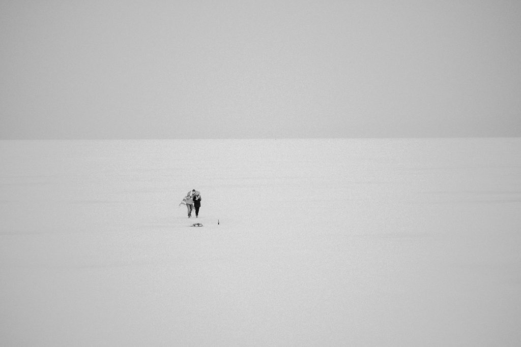 Winter engagement photos on frozen lake Winnipeg