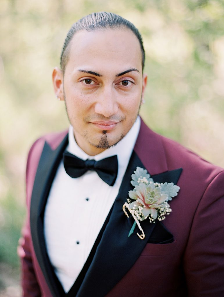 Handsome groom looks like the Rock