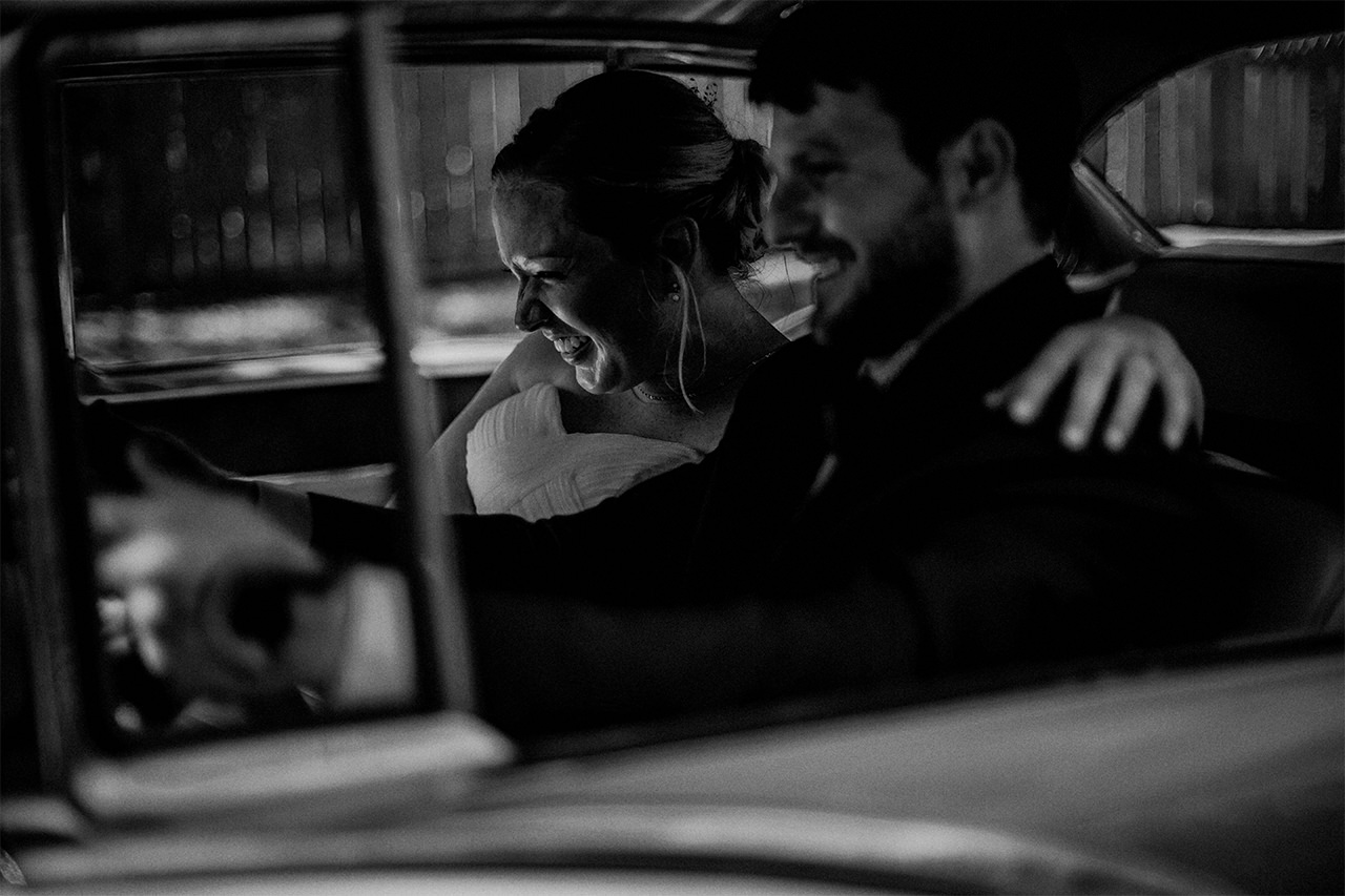 Bride and groom moments in Classic car